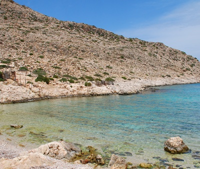 /media/28804729/shutterstock_62978200_kania-secluded-beach_halki_greece.jpg